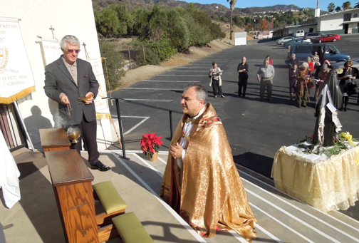 Photo courtesy of Al RESTIVO Shown offering and leading prayers at the Shrine is Monsignor Antonio Cacciapuoti.