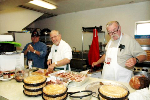 Photo by Dick CLUBB Veterans from the American Legion and VFW including (from left) Jim Turner, Mike Baldwin and Warren Spayth shown here preparing for the organizations' Dec. 14 dinner, collected about 175 items for families in need.