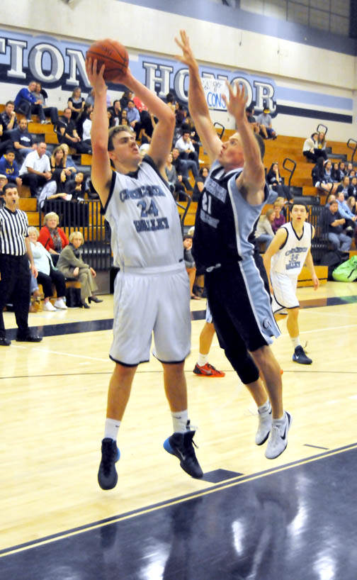 Photo by Jason BALLARD Eric Patten goes up against CV alum Matt Oliver in the Nov. 27 alumni game. The varsity lost to he alumni 69-64.