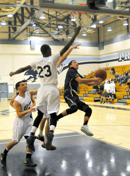 Flintridge Prep's Kyle Hamane (shown here against Cleveland) led the Rebels with 12 points against Verdugo Hills, but the team lost 60-36. The Rebels (2-2) play today, hosting Sierra Canyon at 7:30 p.m.