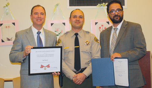 Photo by Mary O'KEEFE Rep. Adam Schiff, left, and Rafi Nazarians, right, of Sen. Barbara Boxer's office, recognized LASD Deputy Tai Plunkett for bravery demonstrated during a stabbing.