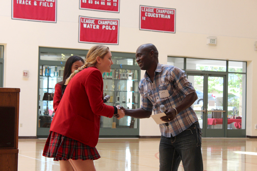 Thomas Awaipo shakes hands with ASB President Kacey Benson.