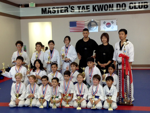 Twenty-six students of MTC in Montrose received medals in the 13th Annual Yong-In Taekwondo Championship held in Huntington Beach. Shown are (back row) Justin Zoltzman, Kaydin Lewis, Lea Oh, Adeline Oh, Instructor Chris, Master Oh and Grand Master Ahn. In the middle row are Joshua Ouh, Nicole Ouh, Kacey Charbonnet, Christopher Watson, Gabriel Kennedy and Alexys Ortiz-Luis. In the front are Kate Weller, Gunnar Sumner, Casey Fishback, Connor Charbonnet, Alec Bedrosian, Eva Dimov, Lyons Mathias and Aidan Oh.