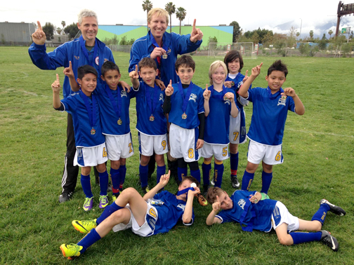 Shown in the top row are coaches Rolf Wyss and Mark Greninger. Standing (from left) are Branden Acuna, Anthony Marquez, Jackson Greninger, Artin Shenian, Silas Earnhardt, Nicola Notaro and Matthew Malhotra. Lying down are Benjamin Elster and Jaeger Wyss.