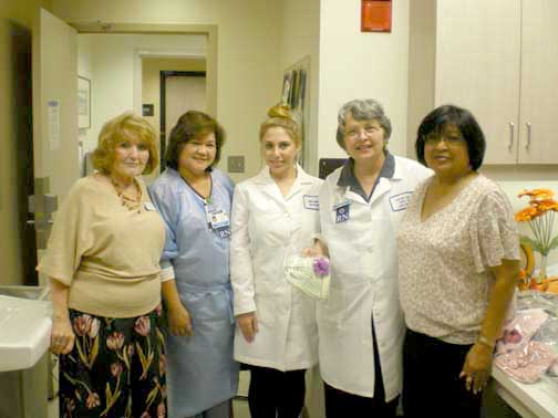 Shown at Kaiser were (from left) LCWC chairperson Sandra Sadderwhite, senior chemotherapy nurse Cecelia Roy, clinical research associate Jennifer Mavian, clinical research nurse Charlene Roske and LCWC volunteer Lucy Leach.