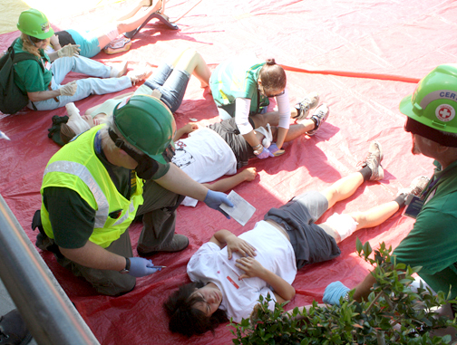 Photos by Mary O'KEEFE CERT members assess and treat victims during a drill held on Saturday at Monte Vista Elementary School.