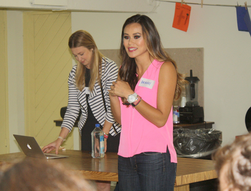 Philanthropist Brandi Milloy introduced the guest speakers of Teen Girl Empowerment Day.