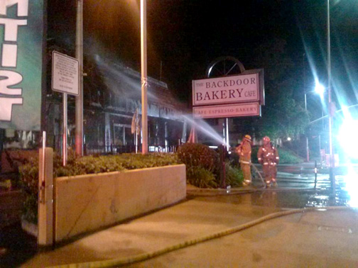 In this photograph, taken from the Backdoor Bakery and Cafe's Facebook page, firefighters battled the early morning blaze that gutted the Backdoor Bakery and Cafe in Sunland on Sunday.