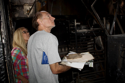 Photos by Michael J. ARVIZU Deborah Goodale and husband Reno survey the damage to the Backdoor Bakery and Cafe on Wednesday. The business was gutted in an early morning blaze on May 11.
