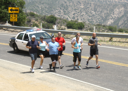 Photo by Mary O'KEEFE CV Sheriff's Station personnel took part in the 37th Annual Memorial Run. The CV station's leg of the run began at the Mill Creek Ranger Station in the Angeles National Forest.