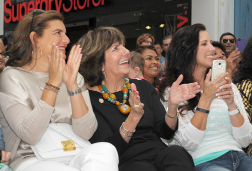 Newly elected Glendale City Councilwoman Paula Devine (second from left) cheered on the show's models.