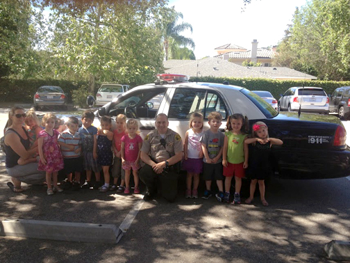 "Students from LCFCCP receive lessons in ""stranger danger"" and safety from Deputy Dan Cortes."