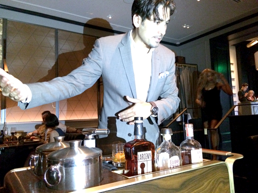 William Mountford, sommelier at Bourbon Steak, provides table side whiskey smoking service.