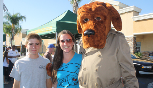 File photo Lucas Martos Repath and Heather Abrams hung out with McGruff the Crime Dog during last year's National Night Out at the Marketplace in the 2600 block of Foothill Boulevard.