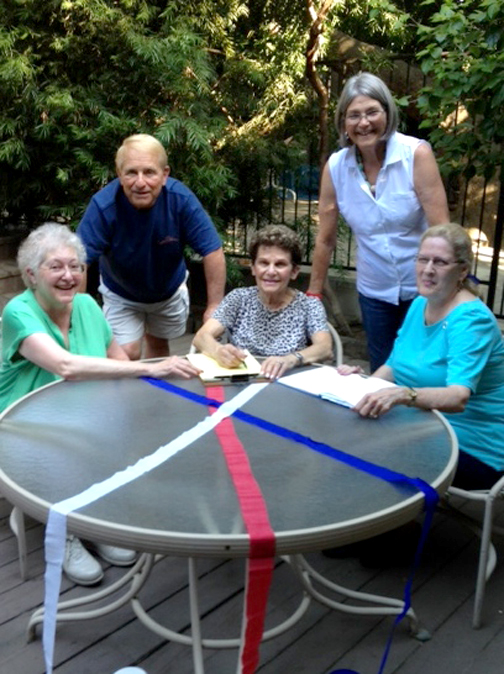Planning for the cool summer picnic are Marsha Hymanson, Chuck Guinta, Jane Chetron, Maggie O'Rourke and Vicki Hays.