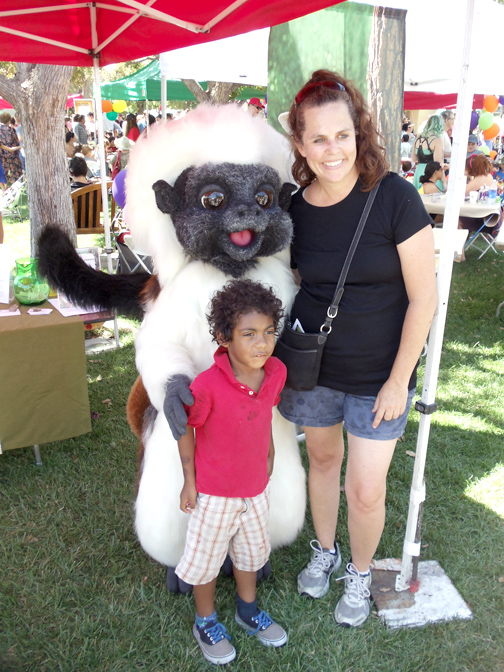 Debra and AJ Stolberg posed with L.A. Zoo's mascot.