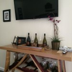 A former wine barrel makes the table/wine rack at the Blair Estates suite at Vendange Carmel Inn and Suites.