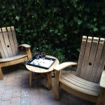 Secluded patio features chairs made of former wine barrels.
