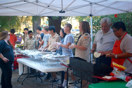 Boy Scouts took turns helping out with the assembly line serving.