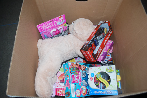 Boxes of donated toys contained bears, board games, trucks and other items for children.