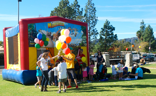 Kids who tagged along or participated were entertained and rewarded with balloons and a bounce house.