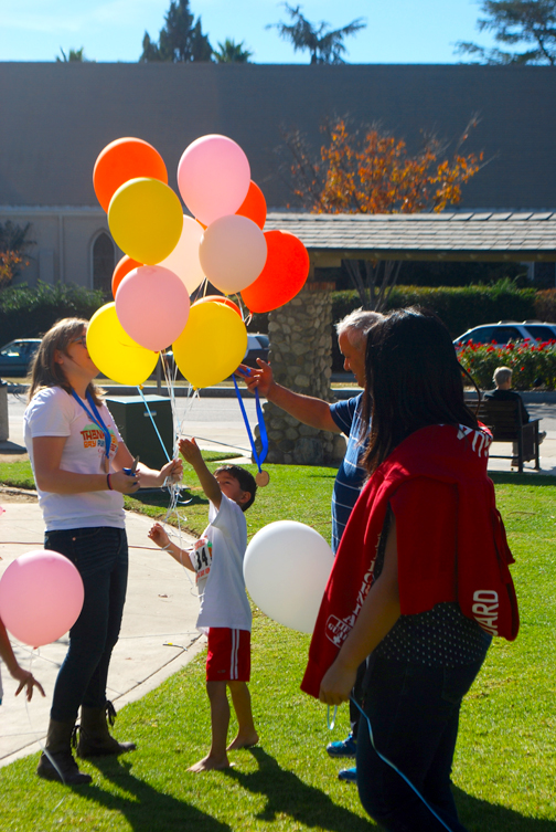 Volunteers passed out balloons as rewards to children for competing and cheering on their family members