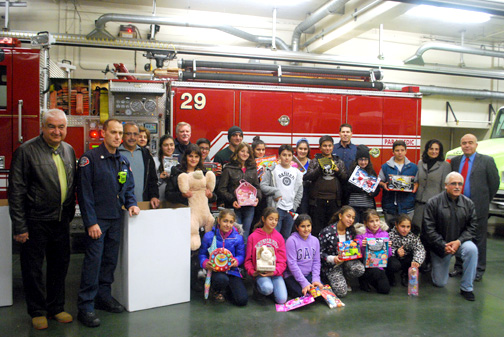 Photos by Samantha SLAYBACK Members of the Armenian Center Outreach Committee outside Glendale Fire Station 29 with firefighters after dropping off boxes of toys for the Spark of Love toy drive.