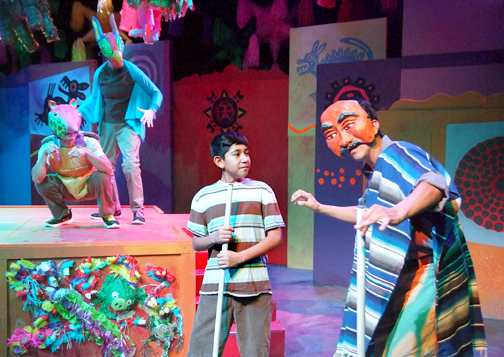 "Photos by Ed KRIEGER  From left, Isaiah Cazares (Itzali), Suzanne Santos (Halipi), Noah Logan Martinez (J.J. Tovar) and David Guerra (Grandfather) in ""Piñata Dreams."""