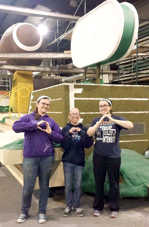 Taking a break from decorating the University of Oregon float are marching band members and CVHS graduates (from left) Lauren Fairshter (tenor sax), Emma Salmon (flute) and Erin Batali (tenor sax).