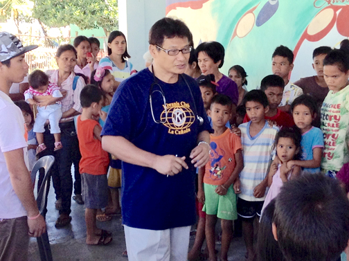 "Dr. Edgio Elio, wearing a Kiwanis Club of La Cañada T-shirt, greets patients at the Tabang ""Help"" Antique Philippines Medical Mission."