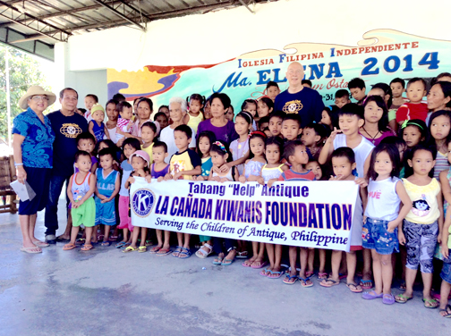 Photos provided by Kiwanis Club La Cañada The children of Antique, Philippines gather to thank Kiwanis donors (left) Dulce and (back row) Tom Passanisi. Next to Dulce is Monsit Lorena, Carit-an, Antique barrio captain.