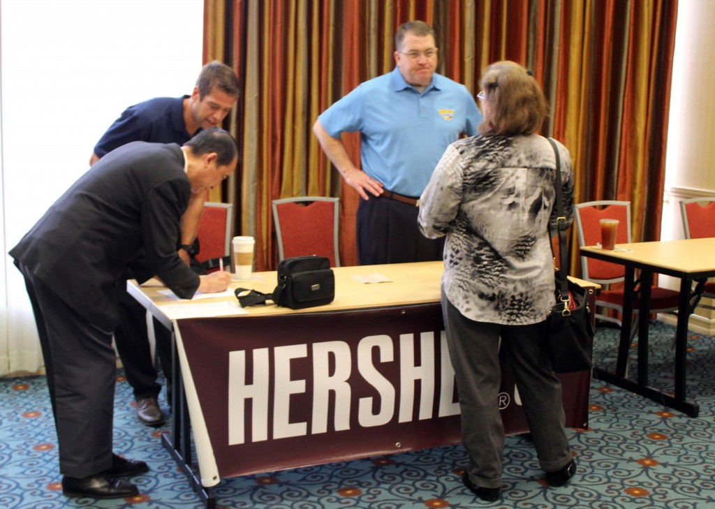 Photos by Isiah REYES Job seekers talk to Hershey reps to learn what opportunities the company might hold for them.
