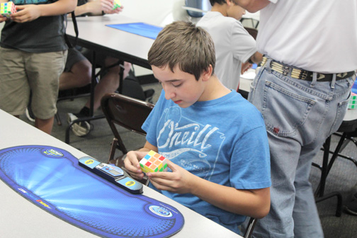 Photos by Isiah REYES A competitor at the Feb. 1 Rubik's Cube Winter Open 2015 Competition at St. Francis High School is intent on beating his opponents.