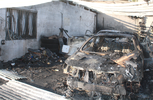 Photos by Mary O'KEEFE Investigators believe arson was behind a fire that destroyed vehicles at CV Tow on Monday morning.