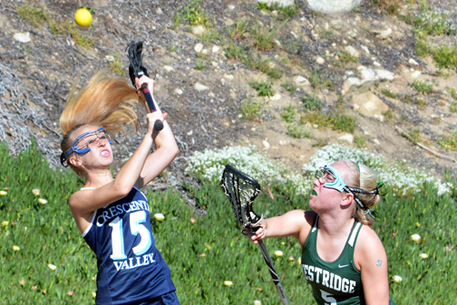 Photos by Dan HOLM Leah Crowther fights for a ball against Westridge on March 12. She assisted on CV's first goal of the game and scored two goals in the 8-7 win.