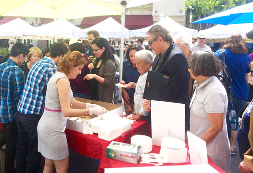 Community members line up for pastries after the ceremony courtesy of Montrose's La Fleur Pastry.
