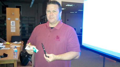 Photo by Isiah REYES GPD Officer Joe Allen shows examples of e-cigs during his presentation on Tuesday