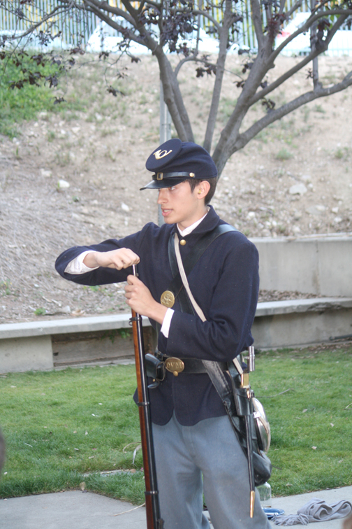 A Union Soldier reenacter shows the battlefield conditions that soldiers would endure during their long marches and bloody battles