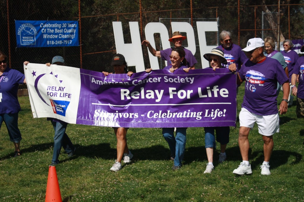 File photo Participants of Relay for Life of the Foothills are preparing for the event on April 11-12. Above  is  the traditional first walk following the opening ceremony. It's not too late to join or support the event. Visit www.relayforlife.org