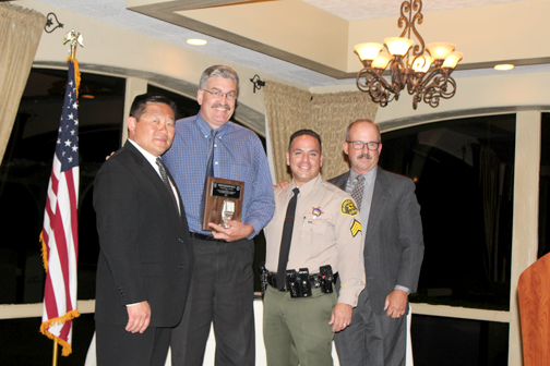 Photos by Isiah REYES CV Sheriff's Station Captain Bill Song, with Silver Mic Award recipient Steve Goldsworthy and Sgt. Joe Larios (in uniform) and Reserve Captain John Camphouse.