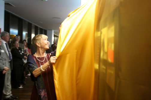 Photos by Jason KUROSU Sue Wilder prepares for the unveiling of the history wall at USC-VHH.