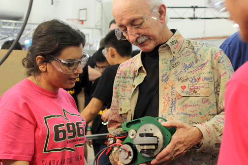 Photo provided by Lauren ROVELLO Clark Magnet senior Cynthia Mirzaie is shown explaining to Woodie Flowers how the Circuitbreaker drive gear box works.
