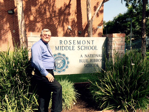 Photo by Mary O'KEEFE Ron Sowers stands in front of his workplace for the last 44 years – Rosemont Middle School. He will be leaving at the end of this school year.