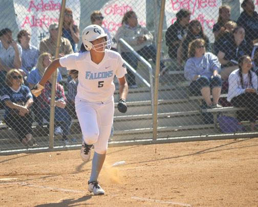Senior Melanie Abzun watches her first homerun go over the fence in the first inning. She hit two homeruns.