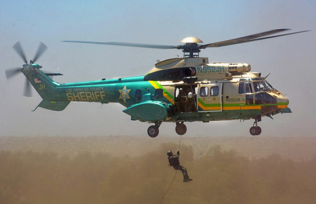 Photos by Dan HOLM LASD Air Rescue 5 shows how hoists can be used to lower emergency medical personnel to injured hikers.
