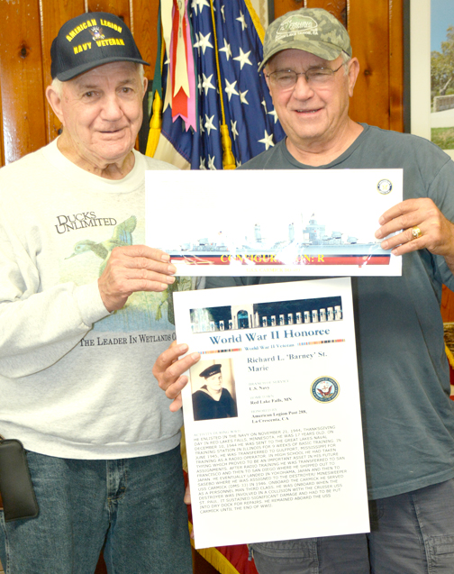 "Photo by Dick CLUBB Richard L. ""Barney"" St. Marie (left) was presented with a copy of the posting on the Registry Of Remembrances by American Legion Post Commander Gerry Collins."