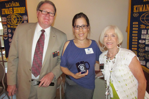 Acting President Chuck Terhune, (left), presented Laurice Levine with the Kiwanis speaker's mug and thanked her for her informative presentation.   Mary Gant, (right) past club president, presented Levine to the club.
