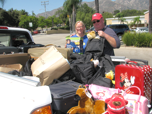 File photo About 240 cases were collected in 2014 said Crescenta-Cañada Lions Club President Art Rinaman, shown at a previous Kases for Kids collection with a program donor.