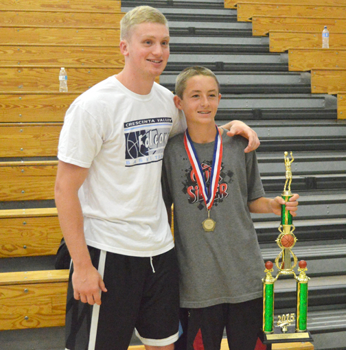 Photos by Brandon HENSLEY Former CVHS player Cole Currie with Camper of the Week Jonathan Martin.