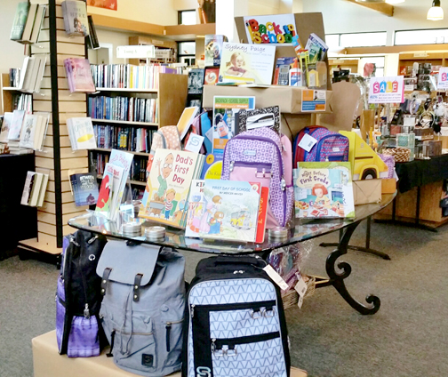A Flintridge Bookstore & Coffeehouse display features school supplies that are part of a donation drive with Sydney Paige® Inc.
